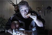 fat man balls - Man Watching TV and Eating Pizza    Stock Photo - Premium Royalty-Freenull, Code: 600-01123500