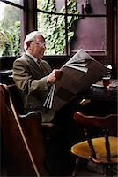 Man Reading Newspaper in Pub    Stock Photo - Premium Royalty-Freenull, Code: 600-01123736