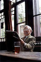 Man Reading Newspaper in Pub    Stock Photo - Premium Royalty-Freenull, Code: 600-01123738