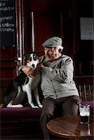 Man With Dog in Pub    Stock Photo - Premium Royalty-Freenull, Code: 600-01123756