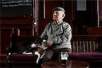 Man With Dog in Pub    Stock Photo - Premium Royalty-Freenull, Code: 600-01123757