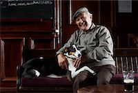 Man With Dog in Pub    Stock Photo - Premium Royalty-Freenull, Code: 600-01123758