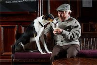 Man With Dog in Pub    Stock Photo - Premium Royalty-Freenull, Code: 600-01123759