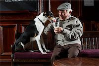 Man With Dog in Pub    Stock Photo - Premium Royalty-Freenull, Code: 600-01123760