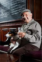 Man With Dog in Pub    Stock Photo - Premium Royalty-Freenull, Code: 600-01123762