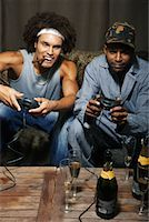 Friends Playing Video Game    Stock Photo - Premium Royalty-Freenull, Code: 600-01124703