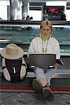 Woman Using Laptop Computer in Airport    Stock Photo - Premium Rights-Managed, Artist: George Shelley, Code: 700-01124810
