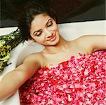 High angle view of a young woman in a bathtub full of rose petals Stock Photo - Premium Royalty-Freenull, Code: 630-01127009