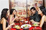 Three young women and a young man dining in a restaurant Stock Photo - Premium Royalty-Free, Artist: TSUYOI, Code: 630-01128883