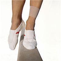 feet gymnast - Female gymnast's feet balancing on balance beam, close-up Stock Photo - Premium Royalty-Freenull, Code: 632-01144981