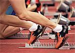 Men in starting position for race, low section Stock Photo - Premium Royalty-Free, Artist: Narratives, Code: 632-01145134