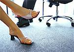 Businessman and businesswoman's feet Stock Photo - Premium Royalty-Free, Artist: Sheltered Images, Code: 632-01147854