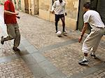 Men kicking soccer ball in street Stock Photo - Premium Royalty-Free, Artist: Robert Harding Images, Code: 632-01148541