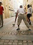 Men playing soccer in street Stock Photo - Premium Royalty-Free, Artist: Robert Harding Images, Code: 632-01148554