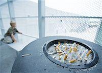 Boy in smoking area Stock Photo - Premium Royalty-Freenull, Code: 632-01160741
