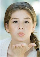preteen kissing - Preteen girl blowing kiss Stock Photo - Premium Royalty-Freenull, Code: 632-01161574