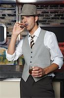 Portrait of Man Smoking Cigar    Stock Photo - Premium Royalty-Freenull, Code: 600-01163422