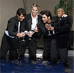Men in Formal Wear Standing in Pool Drinking Cocktails    Stock Photo - Premium Royalty-Free, Artist: Masterfile, Code: 600-01163506