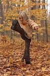 Girl Kicking Leaves
