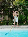 Boy Cleaning Swimming Pool