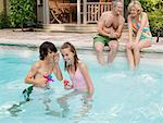 Family Pool Side    Stock Photo - Premium Royalty-Free, Artist: Masterfile, Code: 600-01164459