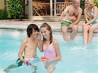 Family Pool Side    Stock Photo - Premium Royalty-Freenull, Code: 600-01164460