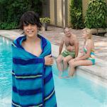 Boy and Grandparents by Swimming Pool