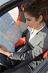 Businesswoman Looking at Road Map    Stock Photo - Premium Rights-Managed, Artist: Siephoto, Code: 700-01164601