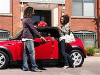 Man Giving Woman New Car