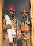 Firefighters Carrying Hose out of Smoky Building    Stock Photo - Premium Royalty-Free, Artist: Masterfile, Code: 600-01172199