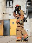 Firefighter Outside of Smoke-filled Building    Stock Photo - Premium Royalty-Free, Artist: Masterfile, Code: 600-01172205