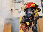 Firefighter Outside of Smoke-filled Building    Stock Photo - Premium Royalty-Free, Artist: Masterfile, Code: 600-01172207