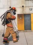 Firefighter Outside of Smoke-filled Building    Stock Photo - Premium Royalty-Free, Artist: Masterfile, Code: 600-01172208