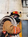 Firefighter Outside of Smoke-filled Building    Stock Photo - Premium Royalty-Free, Artist: Masterfile, Code: 600-01172209