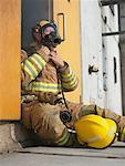 Firefighter in Doorway of Smoke-filled Building    Stock Photo - Premium Royalty-Free, Artist: Masterfile, Code: 600-01172219