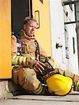Firefighter in Doorway of Smoke-filled Building    Stock Photo - Premium Royalty-Free, Artist: Masterfile, Code: 600-01172220