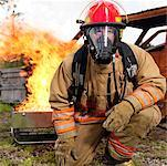 Portrait of Fire Fighter by Fire    Stock Photo - Premium Royalty-Free, Artist: Masterfile, Code: 600-01172239
