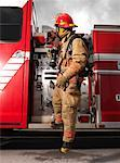 Fireman Pulling Fire Hose from Fire Truck    Stock Photo - Premium Royalty-Free, Artist: Masterfile, Code: 600-01172245