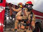 Firefighters Pulling Fire Hose from Fire Truck    Stock Photo - Premium Royalty-Free, Artist: Masterfile, Code: 600-01172248