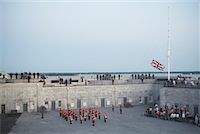 flag at half mast - Sunset Ceremony at Fort Henry, Kingston, Ontario, Canada    Stock Photo - Premium Rights-Managednull, Code: 700-01172323