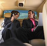 Businesswoman on Cell Phone and Businessman using Laptop, in Limo    Stock Photo - Premium Rights-Managed, Artist: Marnie Burkhart, Code: 700-01172489