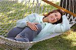 Woman Lying in Hammock    Stock Photo - Premium Rights-Managed, Artist: Matthew Wiley, Code: 700-01172931