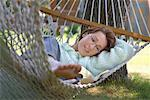 Woman Reading on Hammock    Stock Photo - Premium Rights-Managed, Artist: Matthew Wiley, Code: 700-01172936