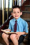 Boy Student Reading on Steps    Stock Photo - Premium Rights-Managed, Artist: Marden Smith, Code: 700-01173179