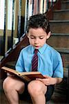 Boy Reading Book on Steps    Stock Photo - Premium Rights-Managed, Artist: Marden Smith, Code: 700-01173181