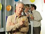 Man at Office Party    Stock Photo - Premium Rights-Managed, Artist: Matthias Tunger, Code: 700-01173246