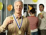 Portrait of Man Holding Wine Glass at Party    Stock Photo - Premium Rights-Managed, Artist: Matthias Tunger, Code: 700-01173292