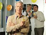 Portrait of Man Holding Wine Glass at Party    Stock Photo - Premium Rights-Managed, Artist: Matthias Tunger, Code: 700-01173293