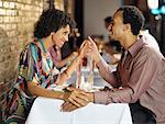Couple Holding Hands in Restaurant    Stock Photo - Premium Rights-Managed, Artist: Mark Leibowitz, Code: 700-01173364