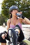 Woman Drinking Outdoors    Stock Photo - Premium Rights-Managed, Artist: Masterfile, Code: 700-01173649